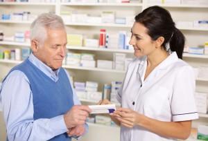 American pharmacist serving  senior man in pharmacy